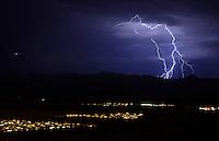 Aug. 21, 2012; Phoenix, AZ, USA: lightning bolt storm monsoon rain cloud night thunderstorm city lights  South Mountain Mandatory Credit: Mark J. Rebilas