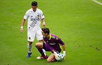 LOS ANGELES, CA - OCTOBER 25: Pablo Sisniega #23 goalkeeper for LAFC protects the ball from Cristian Pavon #10  of the Los Angeles Galaxy during a game between Los Angeles Galaxy and Los Angeles FC at Banc of California Stadium on October 25, 2020 in Los Angeles, California.
