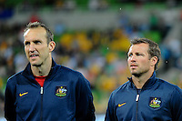 Mark SCHWARZER and Lucas NEILL of Australia wait for the national anthem during the FIFA 2014 World Cup Group D Asian Qualifier match between Australia and Saudi Arabia at AAMI Park in Melbourne, Australia...This image is not for sale on this web site. Please contact Southcreek Global Media for licensing:.Toll Free: 1.800.934.5030.Canada: 701 Rossland Rd. East, Suite 315, Whitby, Ontario, Canada, L1N 9K3.USA: 10792 Baron Dr, Parma OH, USA 44130.Web: http://southcreekglobal.net/ and http://southcreekglobal.com/