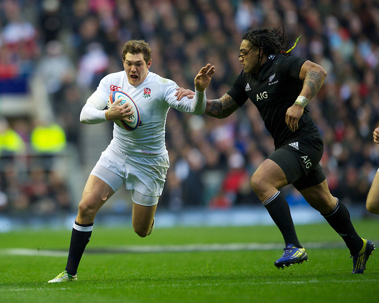Alex Goode of England in action against Ma'a Nonu of New Zealand during the QBE Autumn International match between England and New Zealand at Twickenham on Saturday 01 December 2012 (Photo by Rob Munro)