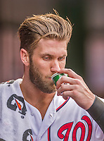 20 September 2015: Washington Nationals outfielder Bryce Harper hydrates in the dugout after scoring against the Miami Marlins at Nationals Park in Washington, DC. The Nationals defeated the Marlins 13-3 to take the final game of their 4-game series. Mandatory Credit: Ed Wolfstein Photo *** RAW (NEF) Image File Available ***