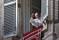Pope Francis  from the window of the apostolic palace overlooking St Peter's square during the Sunday Angelus prayer, on November 19, 2017 in Vatican.
