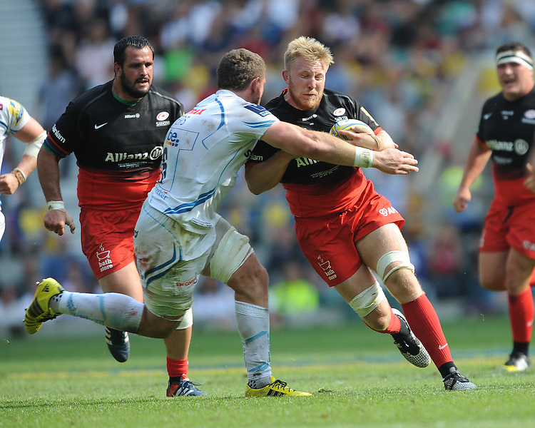 Jackson Wray of Saracens is tackled by David Ewers of Exeter Chiefs during the Aviva Premiership Rugby Final between Saracens and Exeter Chiefs at Twickenham Stadium on Saturday 28th May 2016 (Photo: Rob Munro/Stewart Communications)