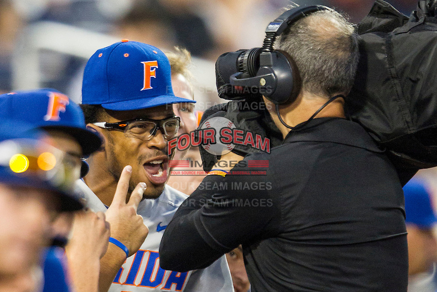 Florida Gators outfielder Buddy Reed (23) clowns around before the NCAA College baseball World Series against the Virginia Cavaliers on June 15, 2015 at TD Ameritrade Park in Omaha, Nebraska. Virginia defeated Florida 1-0. (Andrew Woolley/Four Seam Images)