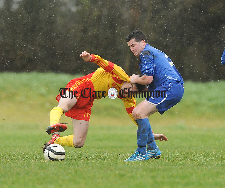 Pat Sherlock of Avenue in action against Ethan Considine of Ennis Town during their Premier League game at Roslevan. Photograph by John Kelly.
