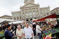 Saturday market in Bundeshausplatz, Bern, Switzerland, 27 August 2011. The Parliament Building is in the background.