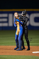 Actresses portraying female Wolverine and Catwoman during an on field performance after a Buffalo Bisons game against the Gwinnett Braves on August 19, 2017 at Coca-Cola Field in Buffalo, New York.  The Bisons wore special Superhero jerseys for Superhero Night.  Gwinnett defeated Buffalo 1-0.  (Mike Janes/Four Seam Images)