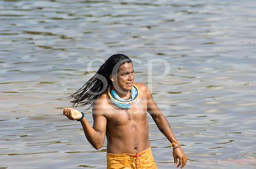 Altamira, Brazil. Ireroko Kayapo, an Indian warrior and teacher from Pukararankre village, bathing in the river.