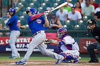 Iowa Cubs third baseman Josh Vitters (1) follows through on his swing against the Round Rock Express in the Pacific Coast League baseball game on July 21, 2013 at the Dell Diamond in Round Rock, Texas. Round Rock defeated Iowa 3-0. (Andrew Woolley/Four Seam Images)