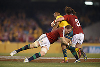 MELBOURNE, 29 JUNE 2013 - Kurtley BEALE of the Wallabies is tackled by Alun WYN JONES of the Lions  during the Second Test match between the Australian Wallabies and the British & Irish Lions at Etihad Stadium on 29 June 2013 in Melbourne, Australia. (Photo Sydney Low / sydlow.com)