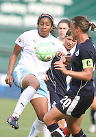 Abby Wambach #20 of the Washington Freedom moves in to tackle Chioma Igwe #12 of the Chicago Red Stars during a WPS match at RFK stadium on June 13 2009 in Washington D.C. The game ended in a 0-0 tie.