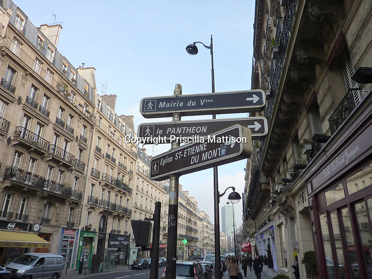 Paris, France - February 2, 2011:  Street signs on rue des Ecoles point to various destinations.