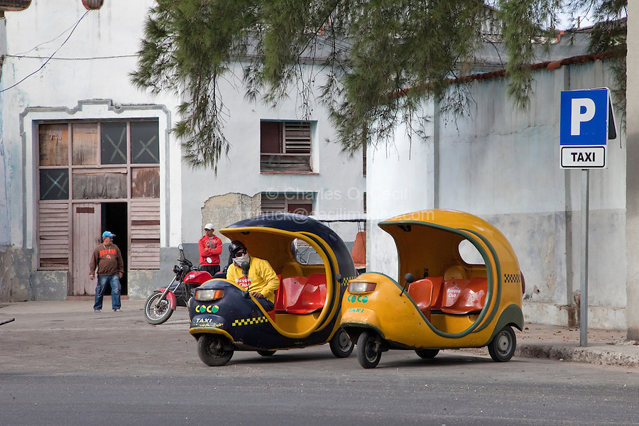 Cuba, Havana.  Two Cocotaxis, a Three-Seater Scooter.