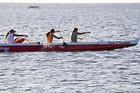 Womens team outrigger canoe paddling near Haleiwa, North Shore of Oahu