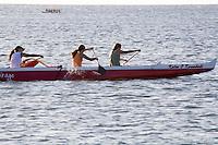 Womens team outrigger canoe paddling near Haleiwa, North Shore of Oahu