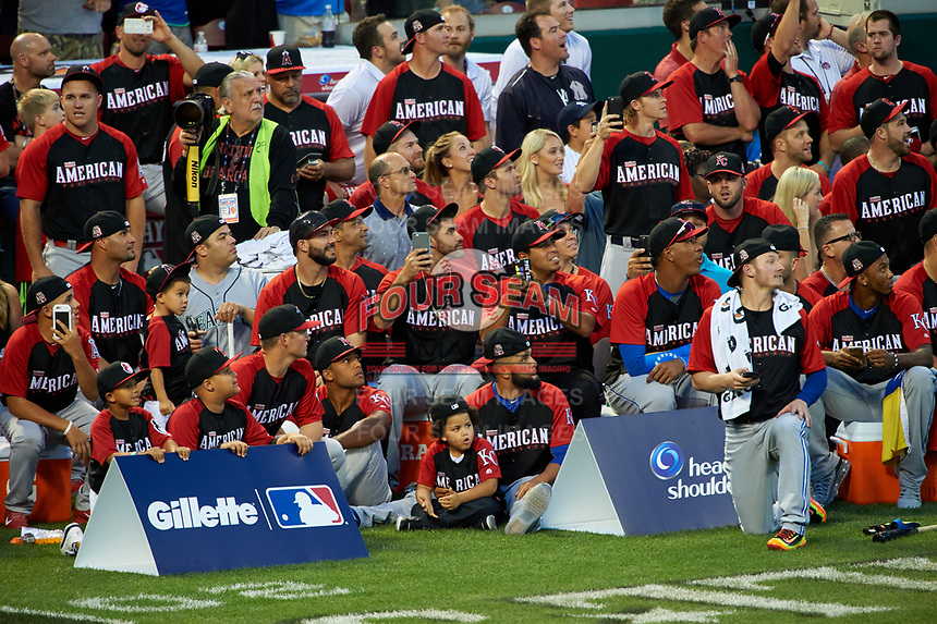 Members of the American League team watch the MLB Home Run Derby on July 13, 2015 at Great American Ball Park in Cincinnati, Ohio.  (Mike Janes/Four Seam Images)