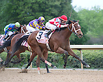 15 APR - Jockey Ramon Dominguez and Harve de Grace (3) takes the lead in  the 47th running of the Apple Blossom Handicap at Oaklawn Park in Hot Springs, Arkansas.
