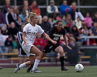 NC State defender Randi Soldat (22) dribbles as Boston College midfielder Kristen Mewis (19) pressures. Boston College defeated North Carolina State,1-0, on Newton Campus Field, on October 23, 2011.