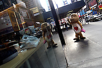 A furry dressed as Tenderheart the Care Bear walks near Times Square, handing out Valentine's Day cards to passers-by.  Furries are a group of people who identify themselves not as being human but as a walking, talking animal.  For some the lifestyle is complete, animal traits reach into every aspect of life from mundane trips to a grocery store to sexual fantasies.  For others, involvement in the furry fandom is limited to public performances and meet-and-greets.