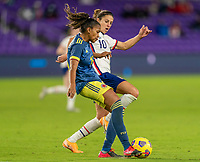 ORLANDO, FL - JANUARY 18: Jorelyn Carabalí #16 of Colombia is defended by Carli Lloyd #10 of the USWNT during a game between Colombia and USWNT at Exploria Stadium on January 18, 2021 in Orlando, Florida.
