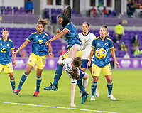 ORLANDO, FL - JANUARY 22: Daniela Arias #3 of Colombia collides with Rose Lavelle #16 of the USWNT during a game between Colombia and USWNT at Exploria stadium on January 22, 2021 in Orlando, Florida.