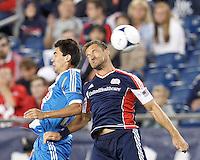 Philadelphia Union midfielder Michael Farfan (21) and New England Revolution defender Flo Lechner (2) battle for head ball. In a Major League Soccer (MLS) match, the New England Revolution tied Philadelphia Union, 0-0, at Gillette Stadium on September 1, 2012.
