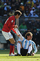 South Korean defender Jung Soo Lee, helps Argentina's Gabriel Heinze to his feet after a hard tackle. Argentina defeated South Korea, 4-1, in both teams' second match of play in Group B of the 2010 FIFA World Cup. The match was played at Soccer City in Johannesburg, South Africa June 17th.