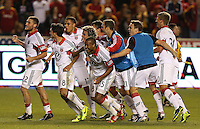 Players of D.C. United celebrate their win over of Real Salt Lake at the U.S. Open Cup Final on October  1, 2013 at Rio Tinto Stadium in Sandy, Utah. DC United beat Real Salt Lake 1-0 to win the championship.