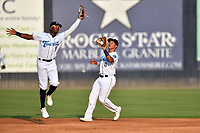 Asheville Tourists  shortstop Freudis Nova (7) and second baseman JC Correa (11) react to the ball during a game against the Hickory Crawdads on July 21, 2021 at McCormick Field in Asheville, NC. (Tony Farlow/Four Seam Images)