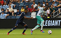 KANSAS CITY, KS - AUGUST 10: Gadi Kinda #17 of Sporting Kansas City  tries to catch up to Andres Mosquera #4 of Club Leon FC as he dribbles the ball upfield during a game between Club Leon FC and Sporting KC at Children's Mercy Park on August 10, 2021 in Kansas City, Kansas.