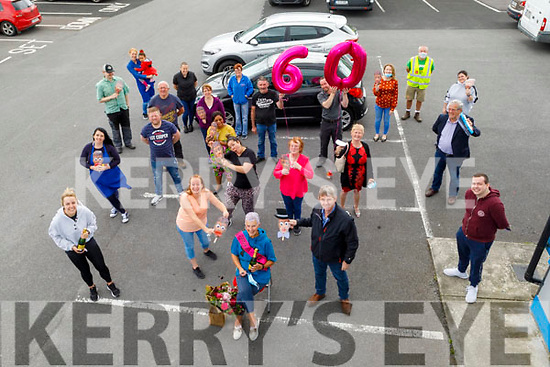 Mary Fahy (seated front) from Tralee  receives a special surprise 60th birthday from her friends in St Vincent's in Monavalley on Friday.