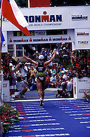 Spectators cheer the runners crossing the finish line of the world renowned annual Ironman triathlon, at Kailua-Kona on the Big Island of Hawaii.