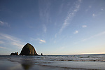 Haystack Rock and Cannon Beach at sunset in Oregon, USA