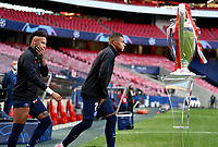23rd August 2020, Estádio da Luz, Lison, Portugal; UEFA Champions League final, Paris St Germain versus Bayern Munich; Neymar and Kylian Mbappe of Paris Saint-Germain walk out to the pitch past the UEFA Champions League Trophy