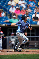 West Michigan Whitecaps third baseman Jordan Pearce (20) follows through on a swing during a game against the Quad Cities River Bandits on July 23, 2018 at Modern Woodmen Park in Davenport, Iowa.  Quad Cities defeated West Michigan 7-4.  (Mike Janes/Four Seam Images)