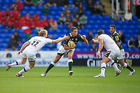 Steven Shingler of London Irish is tackled by Sam Vesty (left) and Carl Fearns of Bath Rugby during the Aviva Premiership match between London Irish and Bath Rugby at the Madejski Stadium on Saturday 22nd September 2012 (Photo by Rob Munro)