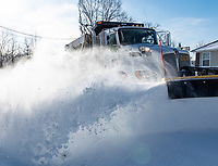 A snow plow clears Theodore Drive  in Bella Vista early Tuesday February 16, 20201 morning.  Check out nwaonline.com/210217Daily/ for today's photo gallery. <br /> (NWA Democrat-Gazette/Spencer Tirey)