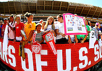 WASHINGTON D.C. - September 02, 2013:<br /> Fans hold up home made banners During a USA WNT open practice at RFK Stadium, in Washington D.C. the day before the USA v Mexico international friendly match.