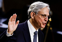 Judge Merrick Garland is sworn in to testify before a Senate Judiciary Committee hearing on his nomination to be U.S. Attorney General on Capitol Hill in Washington, U.S., February 22, 2021.<br /> Credit: Carlos Barria / Pool via CNP /MediaPunch