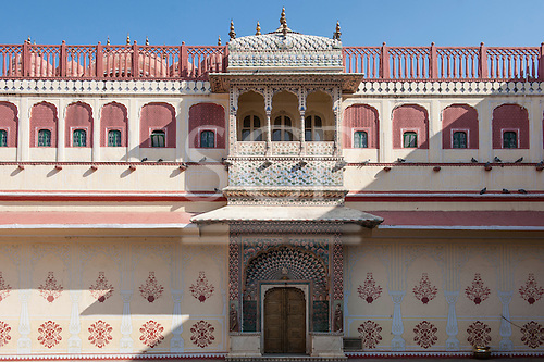 Jaipur, India. The  City Palace Pritam Niwas Chowk courtyard; detail of the Southwest Lotus gate, dedicated to Lord Shiva-Parvati with painted flowers and petals.