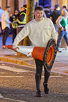 Pictured: A man carries a cone up the street. Friday 14 December 2018<br /> Re: Revellers in Wind Street, Swansea, Wales, UK.