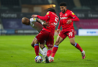30th December 2020; Liberty Stadium, Swansea, Glamorgan, Wales; English Football League Championship Football, Swansea City versus Reading; Andre Ayew of Swansea City is tackled by Tom McIntyre of Reading FC