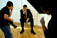 Yao Ming poses for a photographer from ESQUIRE(China) Magazine in an indoor basketball court in Beijing, China. September 4, 2006  (photo by Lou Linwei/Sinopix)