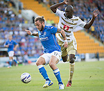 St Johnstone v FC Luzern...24.07.14  Europa League 2nd Round Qualifier<br /> Stevie May holds off Sally Sarr<br /> Picture by Graeme Hart.<br /> Copyright Perthshire Picture Agency<br /> Tel: 01738 623350  Mobile: 07990 594431