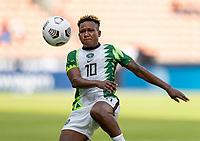 HOUSTON, TX - JUNE 10: Rita Chikwelu #10 Nigeria controls the ball during a game between Nigeria and Jamaica at BBVA Stadium on June 10, 2021 in Houston, Texas.