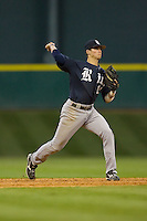 Shortstop Rick Hauge #11 of the Rice Owls makes a throw to first base versus the Texas A&M Aggies in the 2009 Houston College Classic at Minute Maid Park February 28, 2009 in Houston, TX.  The Owls defeated the Aggies 2-0. (Photo by Brian Westerholt / Four Seam Images)
