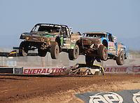 Apr 17, 2011; Surprise, AZ USA; LOORRS driver Jeremy McGrath (2) leads Robby Woods (99) during round 4 at Speedworld Off Road Park. Mandatory Credit: Mark J. Rebilas-