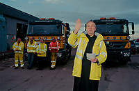 The Reverend Ian Cuthbertson of Gosberton Church  blessing the Council gritters at Pode Hole Depot, Linconshire where prayers are given for the safety of drivers during the Winter months before the gritting vehicles set off to deposit salt on the county's roads to combat the icy conditions.