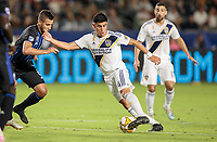 CARSON, CA - SEPTEMBER 21: Joe Corona #14 of the Los Angeles Galaxy turns with the ball during a game between Montreal Impact and Los Angeles Galaxy at Dignity Health Sports Park on September 21, 2019 in Carson, California.