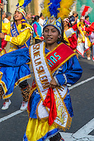 Lima, Peru.  Young Peruvian Woman Marching in an Andean Cultural Parade, Plaza de Armas.